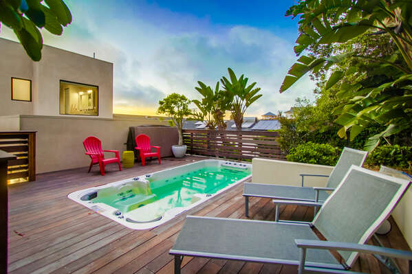 Hot Tub, Outdoor Chairs, and Lounge Chairs on the Deck.