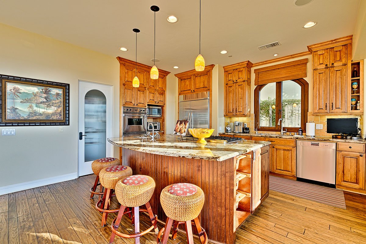 The breakfast bar and island offer usable prep space