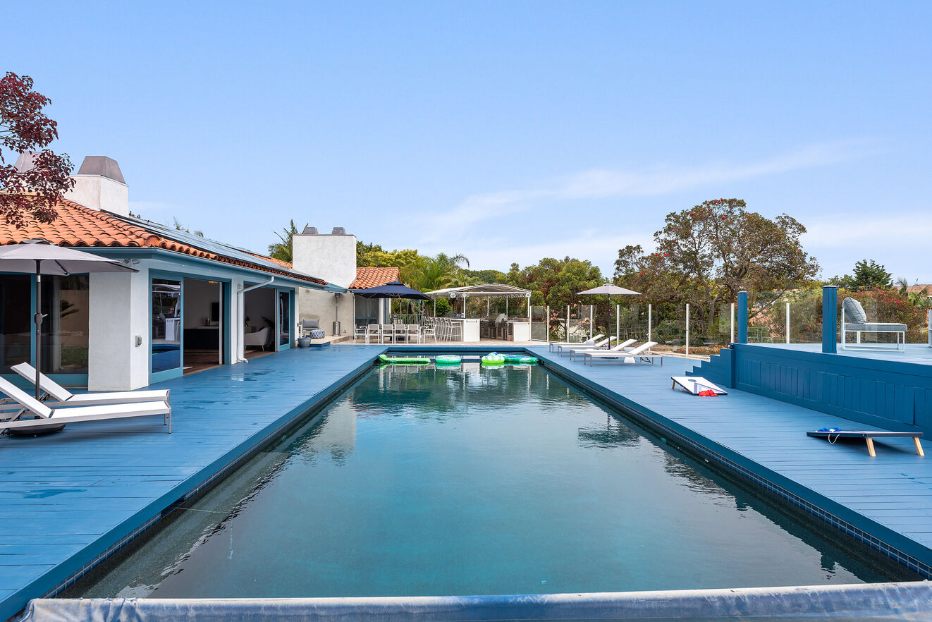 Huge solar heated pool with oversized hot tub.
