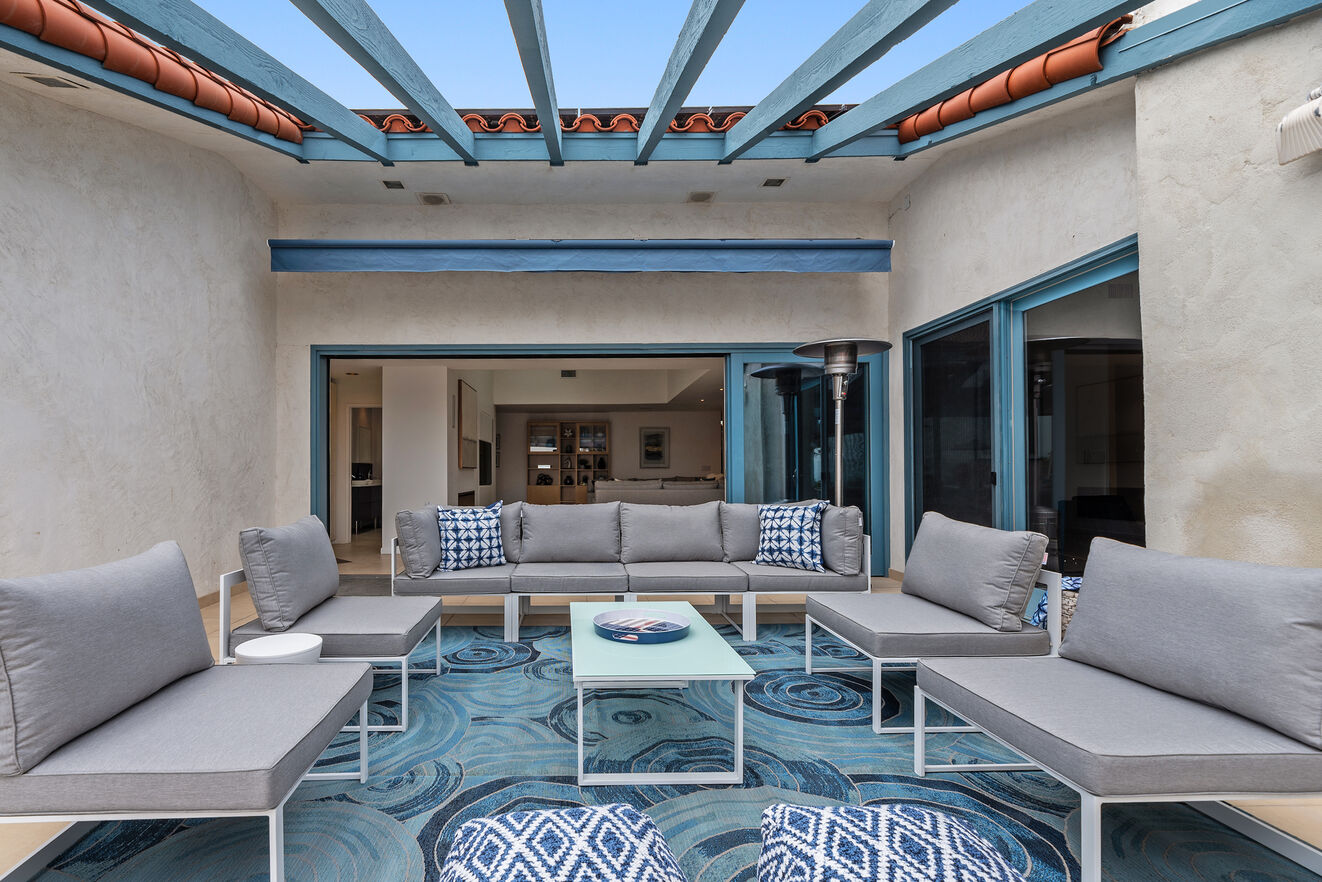 Outdoor living area off the main great room with plenty of sofas to lounge and converse.