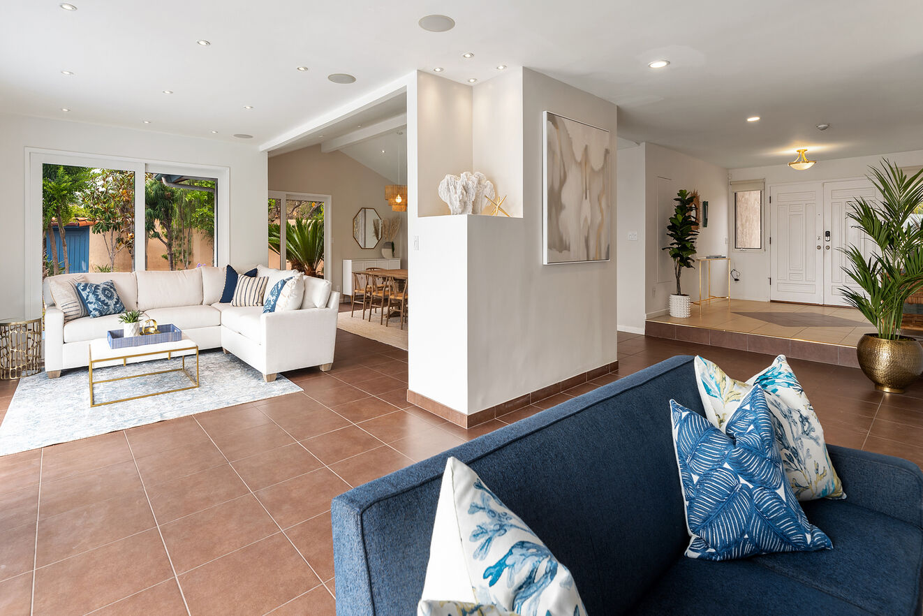 Walk into the open space with formal dining room and two living areas open to the pool area