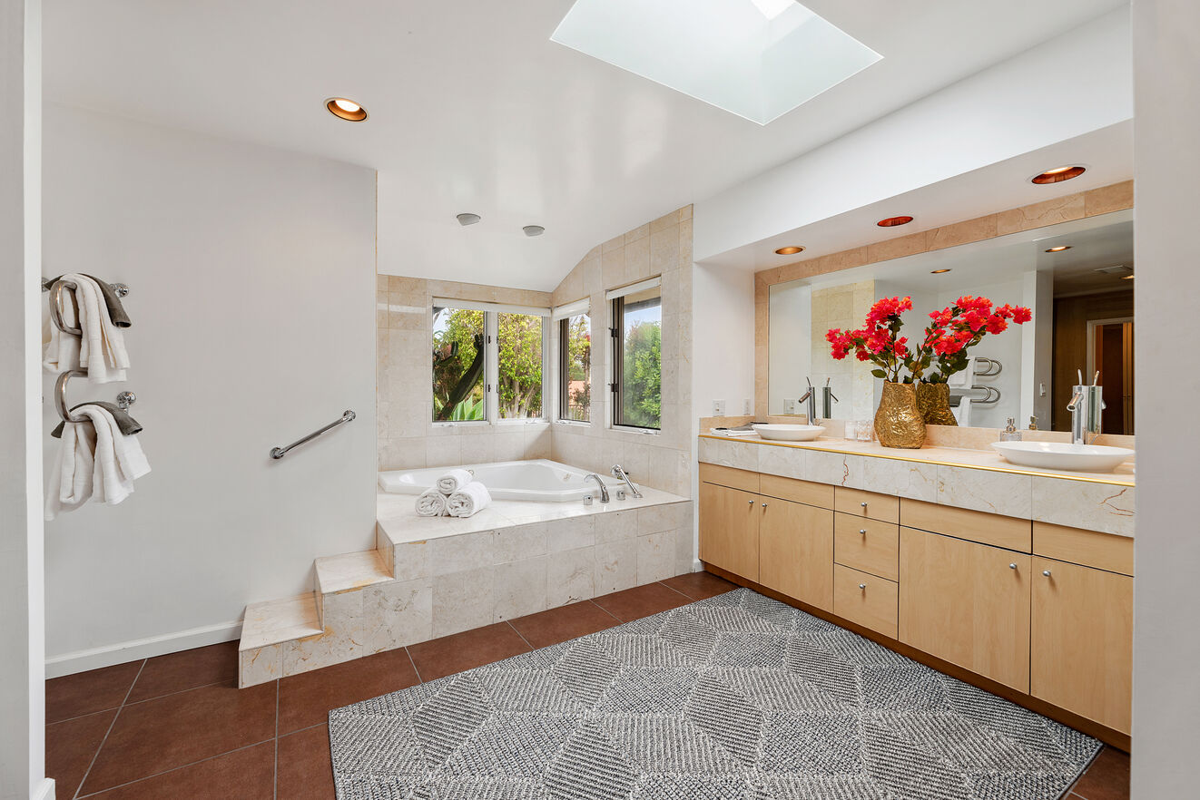 Spacious master bathroom with heated towel holders.