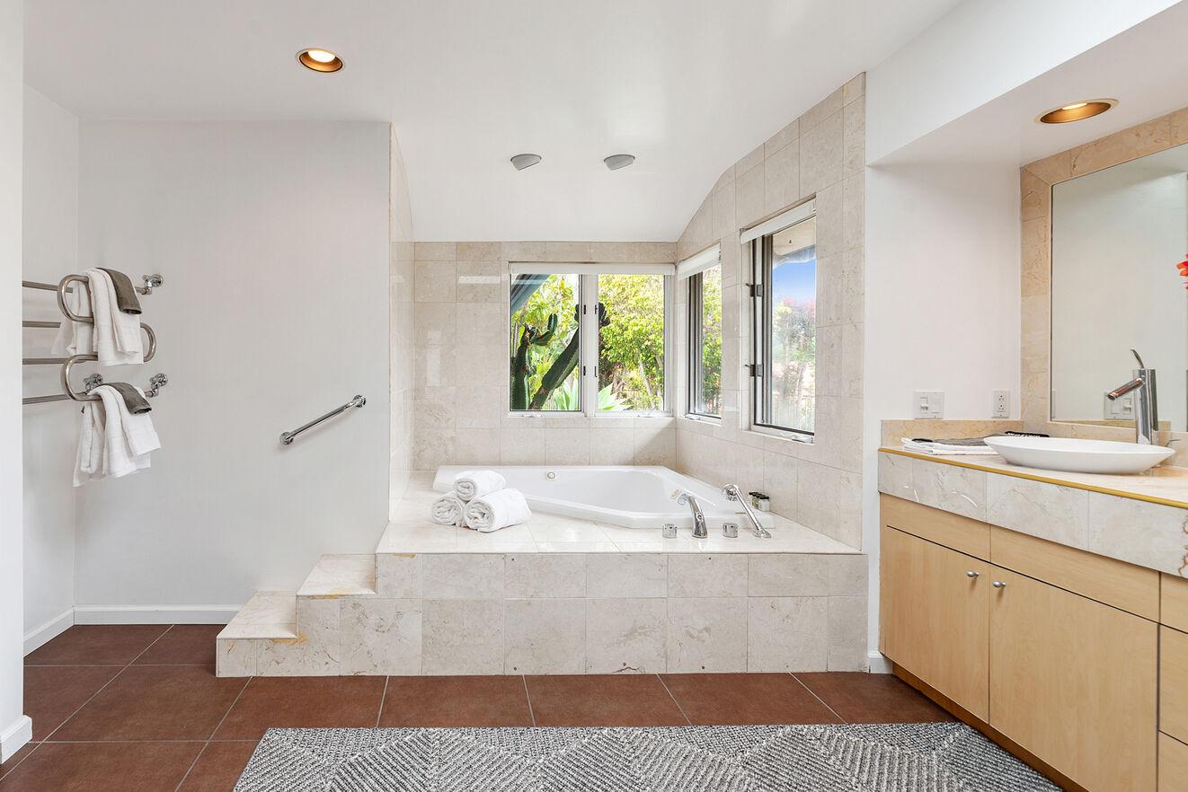 Master bathroom, inviting and spacious.