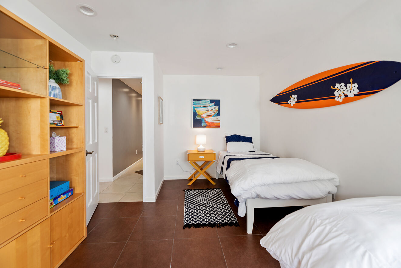 Bedroom #4 with 2 Twin size beds and shared bath separately accessed from the hall.