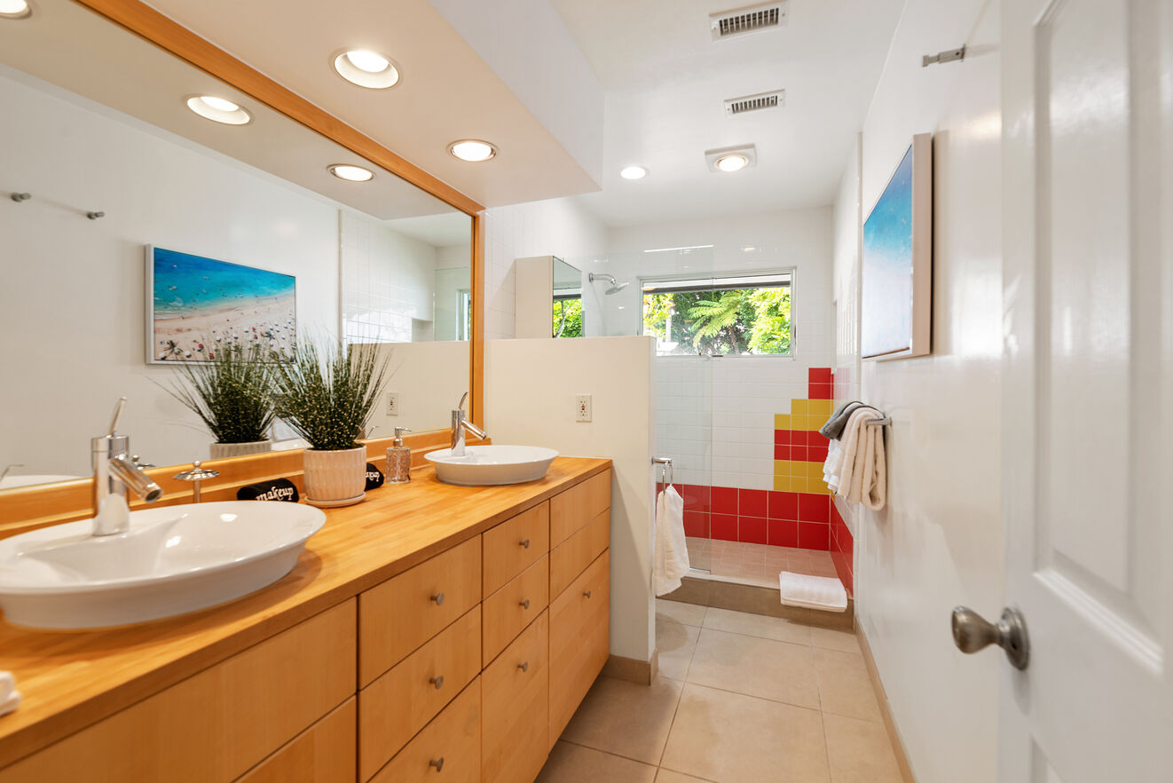 Shared bathroom separately accessed from the hallway with double vanities and shower between Bedrooms #4 and #5