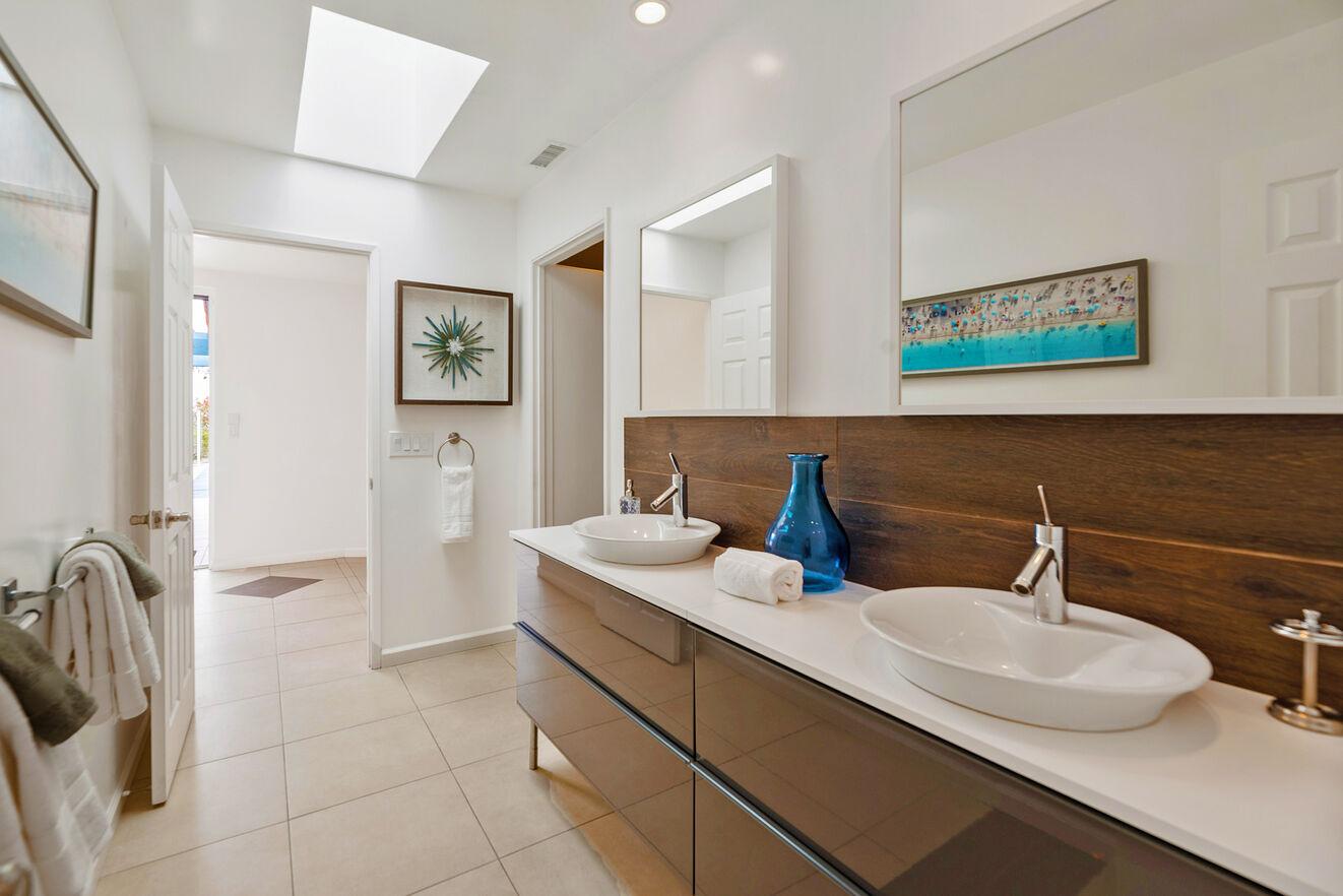 Bathroom serving Bedroom 1 with double vanities and shower