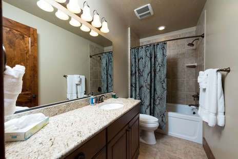 Detached full bathroom located on the lower level