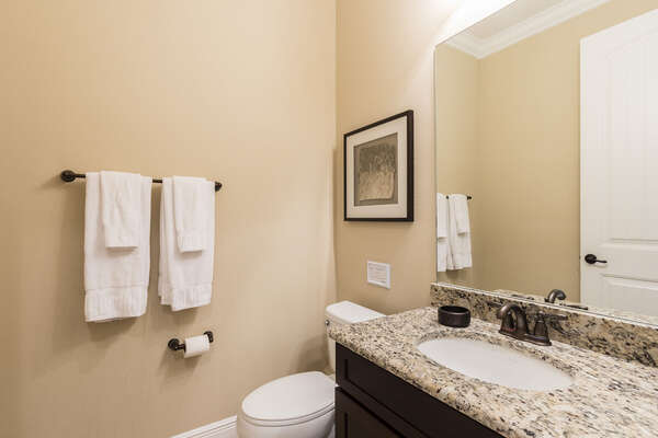 The half bathroom is located on the ground floor