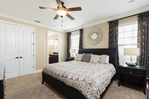 The master suite on the ground floor features a King bed and en-suite bathroom