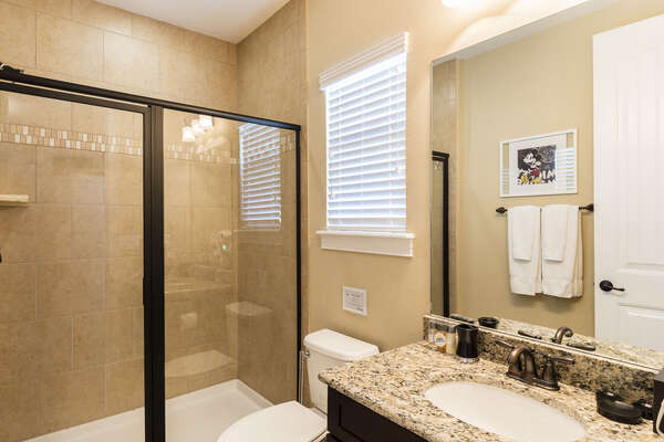 The kids private bathroom has a walk-in shower