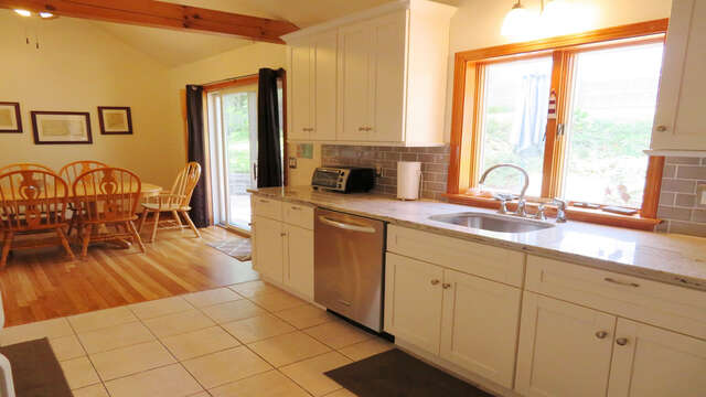 Sliders of dining and kitchen area to deck make for easy barbecuing!  180 Hardings Beach Road Chatham Cape Cod - New England Vacation Rentals