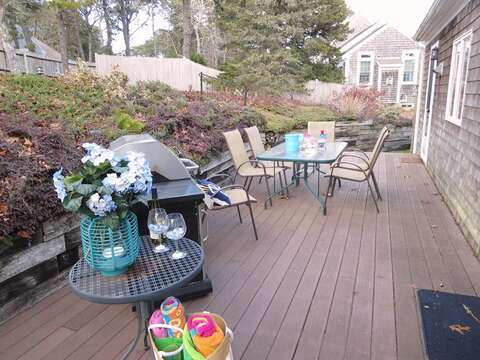 Large back deck with outdoor furniture-easy access from dining room- Mostly fenced in back yard for fido! 180 Hardings Beach Road Chatham Cape Cod - New England Vacation Rentals