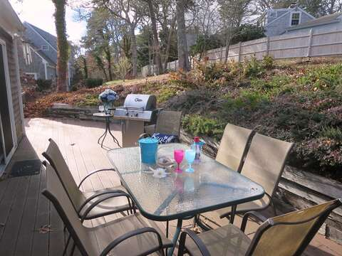 Outdoor dining- steps to upper yard- partially fenced for privacy-180 Hardings Beach Road Chatham Cape Cod - New England Vacation Rentals