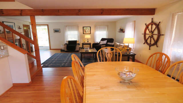 View of dining to living room - all open to kitchen as well plus staircase to 2nd floor-180 Hardings Beach Road Chatham Cape Cod - New England Vacation Rentals