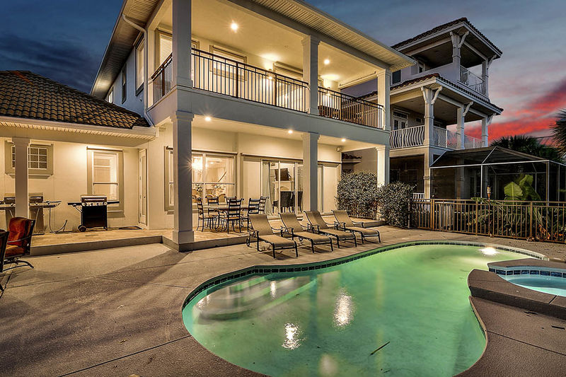 Backyard pool at this Destiny West Vacation Rental