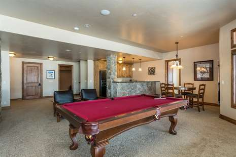 Downstairs Family Room with Pool table, Theater Room with Apple TV only and Kitchenette