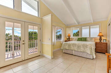 Upper-Level Master Bedroom with Cal King Bed, nightstands, & Lanai Access.