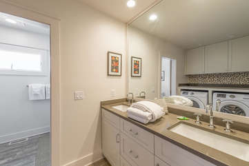Full bathroom by 2nd bedroom also has front load washer/dryer for your use.