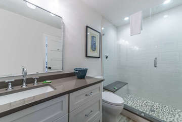 The en suite bathroom offers privacy for the guests in this room.