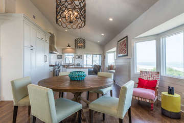 Dining table to enjoy meals or games after the beach.  Bay windows all along the wall offers ocean views!