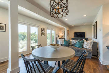 The lower level family room is surrounded by windows with beach views