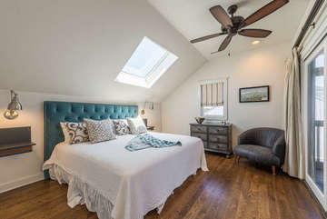 The master retreat is on the 2nd floor. It features a king bed and sliding doors leading to the deck with ocean view.