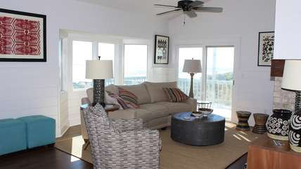 The living area features a comfortable, modern decor.