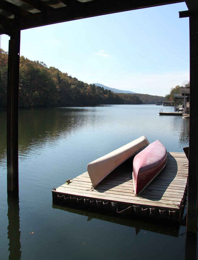 Two Canoes on Wooden Dock. at Smith Mountain lake