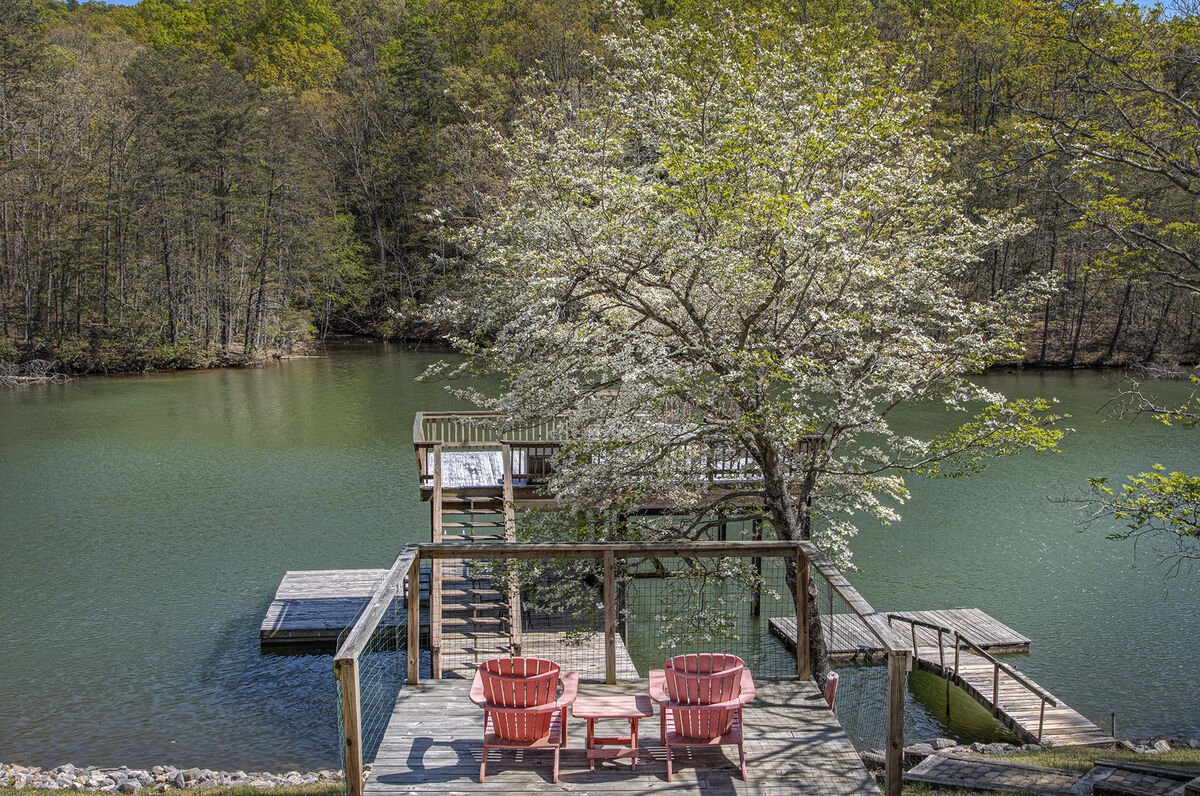 Wooden Deck Overlooking Lake and Dock.