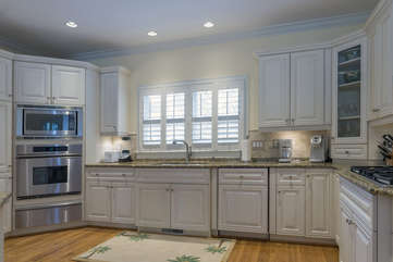 New stainless steel high end appliances include: wine fridge, microwave/convection oven, and separate warmer.