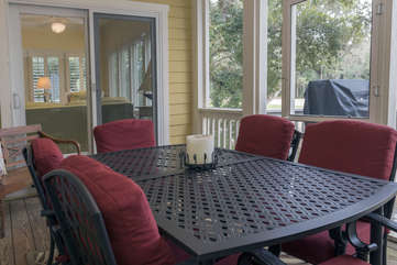 The gas grill is conveniently located off the screen porch