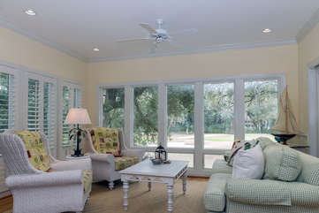 Spacious sunroom with golf course view.
