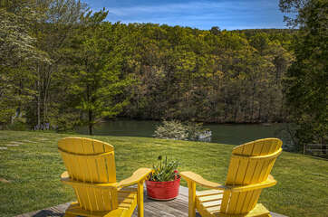 Two Yellow Chairs Overlooking Lake.