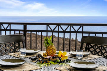 Fruit sits on the middle of the lanai table.