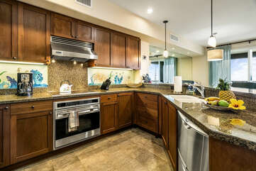Fully equipped kitchen with stainless steel oven range, microwave, and dishwasher.