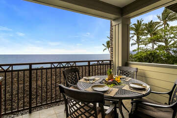 Spacious ocean front lanai with table and seating for 4.