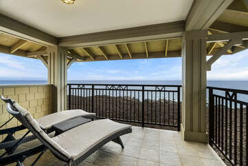 Upstairs Main en-suite lanai of this Kona Hawaii vacation rental with two cushioned lounges.