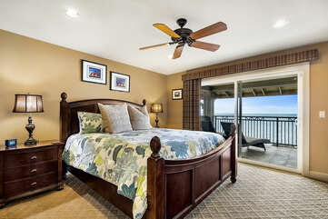 The main suite with a King bed and twin nightstands, by a sliding glass door to the private lanai.