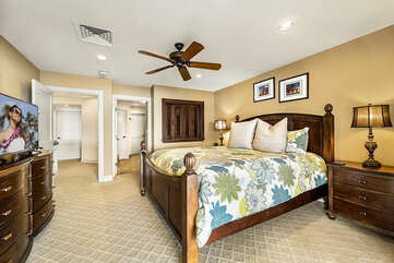Main suite with King bed, flat-screen TV, dresser, and nightstands.