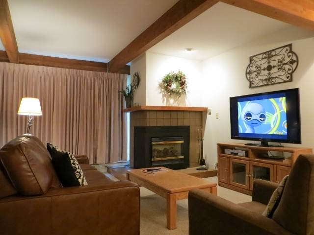 The Living Room Features a Gas Fireplace for Coziness