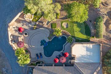 Bird's eye view of magnificent vacation home's outdoor resort amenities.