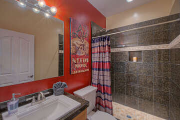 Attached casita features a full bath with a large walk-in tile shower.