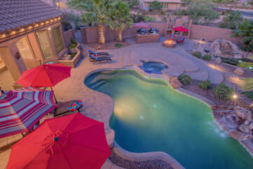 Private backyard has exciting resort amenities that include a gorgeous pool with optional heating, spa, putting green, basketball hoop, fire pit, fireplace and more.
