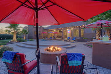 Enjoy the glow and warmth from the gas fire pit or wood burning fireplace in the backyard paradise at Mesa Desert Oasis.