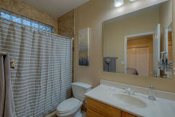 Pretty third bath with walk-in shower is private bath of the fourth bedroom.