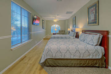 Fifth bedroom offers a different sleeping arrangement of two king beds and a secluded sitting area for watching the Smart TV.