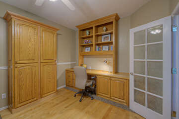 Fifth bedroom has a large desk with laptop space for remote work.