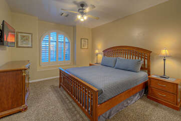Third bedroom with 2 queen beds, lovely arched window and Smart TV shares Jack and Jill bath with second bedroom.