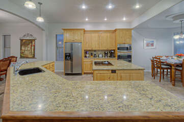 Completely stocked designer kitchen has newly added kitchen utensils plus a wine fridge for our wine enthusiasts.