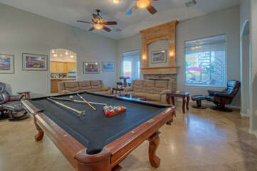 Return home from your vacation a pool shark by practicing your shots on great room's grand pool table.